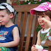 Newburyport: Twins, Janie and Will Schack, 2, of Newbury, enjoy a frozen treat outside of Simply Sweet in Newburyport Monday afternoon. Photo by Ben Laing/Staff Photo