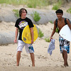 Newbury: Dylan Sherwood, left, and Barrett Jackson, left, both 16, head off the beach at Plum Island after a day of skim boarding Wednesday afternoon. Photo by Ben Laing/Staff Photo