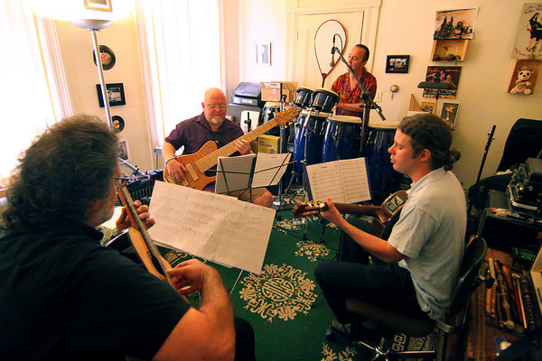 Newburyport: Members of the Latin Quarter, a four piece band influenced by flamenco and latin rhythms, rehearse for their show Sunday afternoon at the Actor's Studio. The group is made up of John Tavano, front, Benjamin Goldblaum, right, Paul Eddy, left, and Roger Ebacher, rear. Photo by Ben Laing/Staff Photo