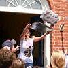 "Newburyport: Rhonda Weisheit, owner of Pralines and Pepper in Newburyport, heaves a tray of cupcakes into the crowd outside her bakery Wednesday afternoon as they were shooting an audition tape for the Food Network show, ""Cupcake Wars"". Photo by Ben Laing/Staff Photo"