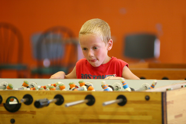 Salisbury: Cameron Paquette, 7, of Salisbury, takes a spin at some foosball at the Boys and Girls Club in Salisbury Tuesday afternoon. Photo by Ben Laing/Staff Photo