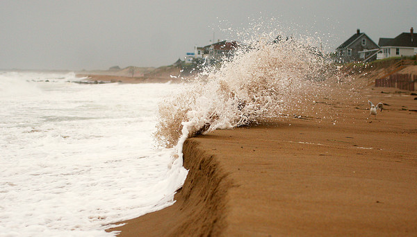 Newbury: Waves pound the beach south of the groin at Plum Island center Monday morning. The surf was unusually high as a nor'easter moved through the region. Photo by Ben Laing/Staff Photo