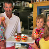 "Newburyport: Ron and Rhonda Weisheit, owners of Pralines and Pepper, along with their two daughters, Raichel, left, and Miah, right, pose with some of their cupcakes. The bakery has been selected to audition for an upcoming Food Network television show, ""Cupcake Wars"". Photo by Ben Laing/Staff Photo"