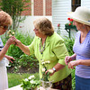 Amesbury: Rosemarie Rodie, left, Cynthia Costello, center, and Pamela Fenner, right, arrange flowers at the Whittier birthplace in Amesbury Wednesday morning. The ladies are preparing the gardens for the annual garden party fundraiser this Sunday. Photo by Ben Laing/Staff Photo