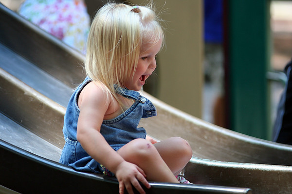 Newburyport: Kay See, 1, of Newburyport, takes a trip down the slide at the tot lot on Inn Street Monday afternoon. Photo by Ben Laing/Staff Photo