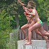 Byfield: Camilla Connelly, front, Katy Haran, center, and Alison Travers, rear, take a leap off the bridge on Middle Road in Byfield Monday afternoon. The trio were former Governor's Academy students, visiting their favorite swimming hole. Photo by Ben Laing/Staff Photo