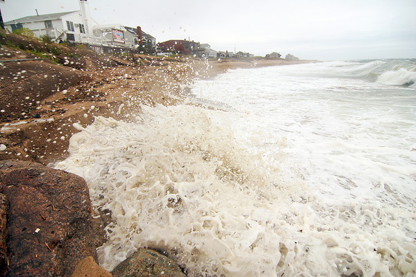 Newbury: The beach at Plum Island center took a beating Monday as high waves pounded the shore due to the nor'easter. Photo by Ben Laing/Staff Photo