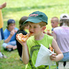 Amesbury: Joey Cotes eats a slice of pizza at Camp Kent in Amesbury Wednesday afternoon. The pizza's were donated by Flatbread Pizza, who came to speak to the children about organic ingredients. Photo by Ben Laing/Staff Photo