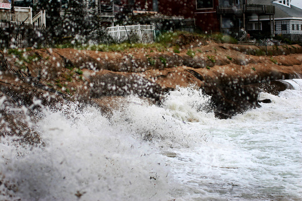 Newbury: Waves smash into the sandbags at Plum Island Tuesday afternoon, which have suffered severe damage from the nor'easter which has struck the region. Photo by Ben Laing/Staff Photo
