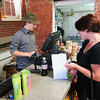 Newburyport: Liam Wilbur helps Michelle Seaberg with her purchase Tuesday morning at the Black Duck Market at the Tannery in Newburyport. The market just opened for bussiness after moving from their former White Hen location on Pond Street. Photo by Ben Laing/Staff Photo