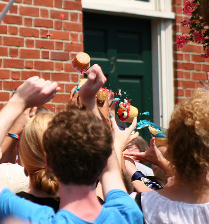 "Newburyport: A barrage of Cookie Monster cupcakes fly into the crowd gathered outside of Pralines and Pepper in downtown Newburyport, as the store was shooting an audtion tape for the Food Network's show, ""Cupcake Wars"". Photo by Ben Laing/Staff Photo"
