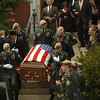 Amesbury: The body of U.S. Army Ranger Sgt. Andrew C. Nicol is taken from the Holy Family Parish in Amesbury yesterday morning after his funeral service attended by hundreds. Bryan Eaton/Staff Photo