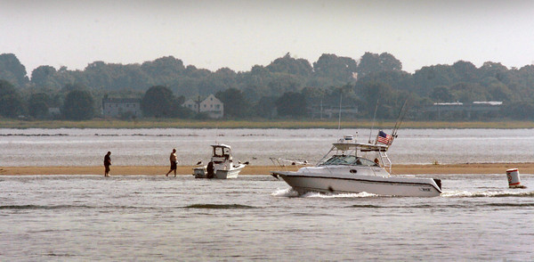 Salisbury: One of the sandbars that have become popular spots for boaters and fisherman, this one off of Ben Butler's Toothpick at Salisbury Beach State Reservation. Bryan Eaton/Staff Photo