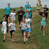 Amesbury: Students in Stephanie Menezes' Run4Fun camp head down the hill at Woodsom Farm in Amesbury yesterday morning. Bryan Eaton/Staff Photo