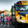 Newburyport: Students get off the bus at the Bresnahan School yesterday morning as classes got underway in the Newburyport School system as well as Seabrook schools. Bryan Eaton/Staff Photo