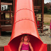 Amesbury: Lydia Hanson, 7, slides down the tube at Amesbury Town Park. The soon-to-be second-grader from Amesbury was there with her mother, Alyssa, during a break in the drizzle. Bryan Eaton/Staff Photo