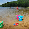 Amesbury: Only a dozen people were at Lake Gardner Beach just after noon yesterday even though temperatures were heading into the '90's. Many people were likely unaware the beach reopened on Saturday after being closed for high bacteria count. Bryan Eaton/Staff Photo
