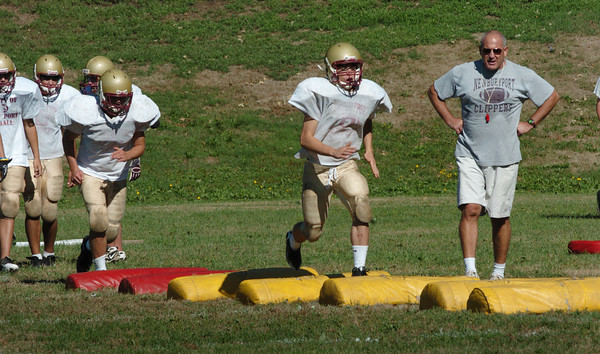 Newburyport: Newburyport High School football coach Ed Gaudiano oversees the team as they go through drills. Bryan Eaton/Staff Photo