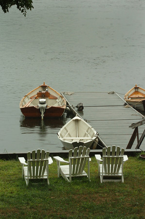 Amesbury: These boats and Adirondack chairs were vacant yesterday afternoon at Lowell's Boat Shop on Point Shore as the drizzle got heavier causing some puddles on Main Street. The weather begins to turn better tonight and into tomorrow. Bryan Eaton/Staff Photo