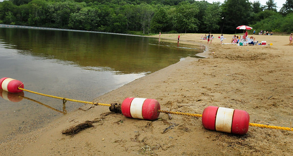 Amesbury: The low water level at Lake Gardner may be even lower this fall if the town goes through with plans to partially drain it and Lake Attitash to target invasive weeds. Bryan Eaton/Staff Photo