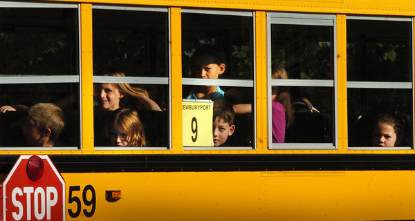Newburyport: Curious faces check out the scene at the Bresnahan School in Newburyport yesterday morning as the school bus pulls up to drop the students off for their first day of classes. Bryan Eaton/Staff Photo