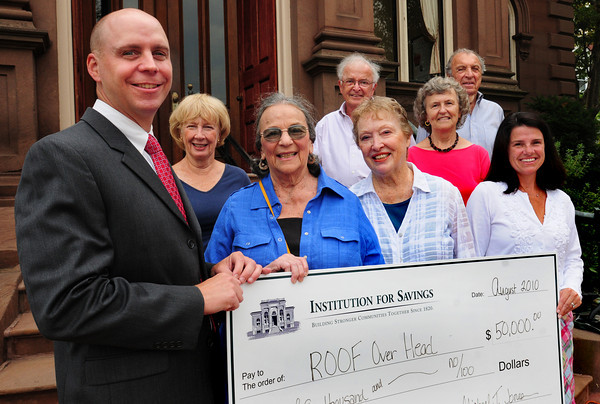 Newburyport: Members of Project Roof were on hand to receive a $50,000 check from Institution President Michael Jones, left, yesterday. From left, Jones, Leslie Eckholdt, site selection committee; Norma Beit, chairman; Bill Carvuth, chairman of governance; Jo An Kincaid, scribe; Annalee Johnson, treasurer; Harvey Beit, fundraising and Kerri Perry. Bryan Eaton/Staff Photo