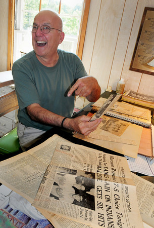 "Rowley: Angelo ""Junior"" Dagres looks through some old clippings of his pro baseball days at his Rowley home. Bryan Eaton/Staff Photo"