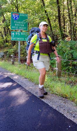 West Newbury: Karen Terzano walks along South Street in West Newbury, heading to Georgetown, on her way to New York. Bryan Eaton/Staff Photo