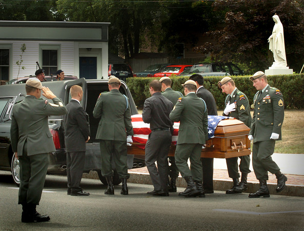 Amesbury: The body of U.S. Army Ranger Sgt. Andrew C. Nicol is placed into a hearse as attendees at his funeral filed out of Holy Family Parish to attend a mercy meal before his body was taken to the New Hampshire State Veterans Cemetery in Boscawen. Bryan Eaton/Staff Photo