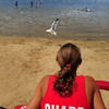 Amesbury: Lifeguards Dana Hubbard and Aggie Egan-Anderson, pictured, watch over a virtually empty Lake Gardner Beach despite Monday's hot weather. The beach reopened Saturday after being closed to due high bacteria count. Bryan Eaton/Staff Photo
