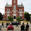 Amesbury: A couple dozen people watched from across the street the funeral of U.S. Army Ranger Sgt. Andrew C. Nicol which was attended by hundreds. Bryan Eaton/Staff Photo