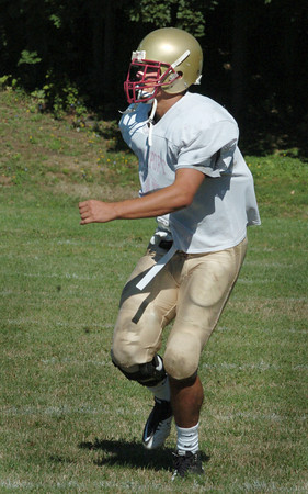 Newburyport: Newburyport's Andrew Sokol goes through drills Friday morning. Bryan Eaton/Staff Photo