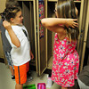 Newburyport: Sami King, left, and Madison Maloney, both 7, show off their different hairstyles to each other after stowing things in their lockers. The two second-graders were beginning the first day of classes in Mary Ellen Hoiseth's class at the Bresnahan School in Newburyport. Bryan Eaton/Staff Photo