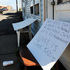 Salisbury: Signs written by tenants displaced from two Salisbury Beach properties deemed uninhabitable are still in front of the premises. Bryan Eaton/Staff Photo
