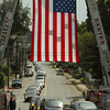 Amesbury: The funeral procession turns onto South Hampton Road in Amesbury under an American flag held up by the Amesbury and Exeter, N.H. Fire Departments' ladder trucks. Bryan Eaton/Staff Photo