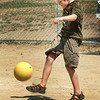 Amesbury: Matthew Proctor, 8, sends the ball to the outfield making it to first base in a game of kickball at the Amesbury Recreation Department's Summer Camp on Monday. He was tagged out, though, just a couple feet from home plate. Bryan Eaton/Staff Photo