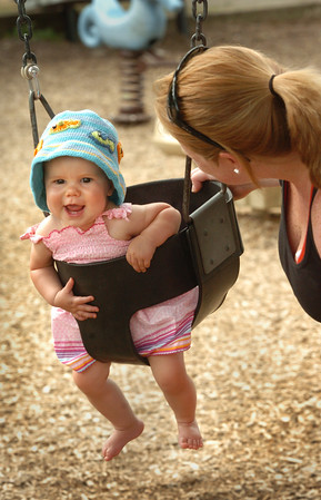 Newburyport: Libby Knapp, 8 months, who is new to swing sets seems to it enjoy it with a big smile. She and her mother, Katie of Newburyport, were with friends at Cashman Park yesterday afternoon. Bryan Eaton/Staff Photo