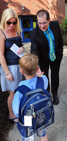 Newburyport: Jennifer Grinnings introduces her son, Phineas, 5, to new Newburyport School's superintendent Marc Kerble at the Brown School which was having orientation for kindergartners yesterday morning. Bryan Eaton/Staff Photo