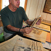 "Rowley: Angelo ""Junior Dagres"" looks through some old clippings of his pro baseball days at his Rowley home. Bryan Eaton/Staff Photo"