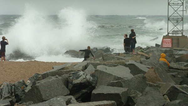 Salisbury: High winds and rough surf at high tide crashed over the rocks at the north jetty at Salisbury Beach State Reservation yesterday morning. There was certainly nobody in the water, but several people were taking photographs.  Bryan Eaton/Staff Photo