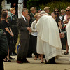 Amesbury: Family members of U.S. Army Ranger Sgt. Andrew C. Nicol are greeted by clergy as they leave the church. Bryan Eaton/Staff Photo