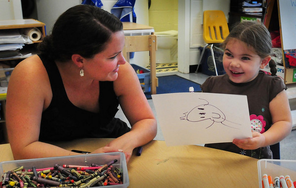 Seabrook: Savannah Curtsinger, 4, shows the picture of her teacher Kirsten Rinally that she drew for her. The pre-schooler at Seabrook Elementary School was there for her orientation for the start of the school year. Bryan Eaton/Staff Photo