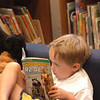 Amesbury: Brendan Robinson, 5, enjoys some quiet time in the air-conditioned children's room at Amesbury Public Library yesterday morning. The Star Wars fan is a resident of Newburyport and likes the Amesbury library. Bryan Eaton/Staff Photo