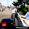 "newburyport: Stephen Blake, 12, of Ipswich plays ""Bluesy"", a song he wrote, on the electric piano Thursday along the boardwalk in newburyport. Jim Vaiknoras/Staff photo"