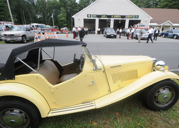 Byfield: Athur Allen's British Coach Works MG Roadster sits across from his funeral , which was held at the Byfield Fire Station Friday morning. Jim Vaiknoras/Staff photo
