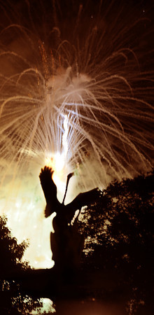 Newburyport: The Yankee Homecoming fireworks explode behind the Swan Fountain at the Bartlet Mall in Newburyport Saturday night. Jim Vaiknoras/Staff photo