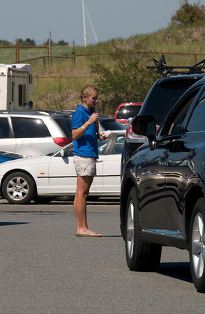 Newburyport: Elisabeth Jones of Newburyport collects fees at the Plum Island Point lot on a hot busy Sunday afternoon. Jim Vaiknoras/Staff photo