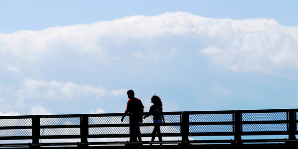 Salisbury: A couple walks across the Gillis Bridge from Salisbury toward Newburyport late Saturday afternoon. Jim Vaiknoras/Staff photo