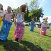 Merrimac: Racers in the sack race sprint to the finish line at the Donahue School at Old Home Days in Merrmac Saturday. Jim Vaiknoras/Staff photo