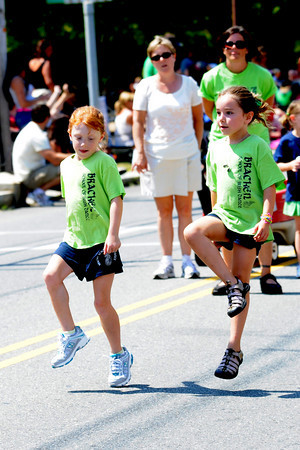 Newburyport: Makala Erickson of Salisbury and Caroline Jacobs of Newbury dance with the Bracken School of Irish Dance down High Street in the Yankee Homecoming Parade Sunday. Jim Vaiknoras/Staff photo